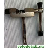 Инструмент для велосипеда, для выжимания звеньев цепи.